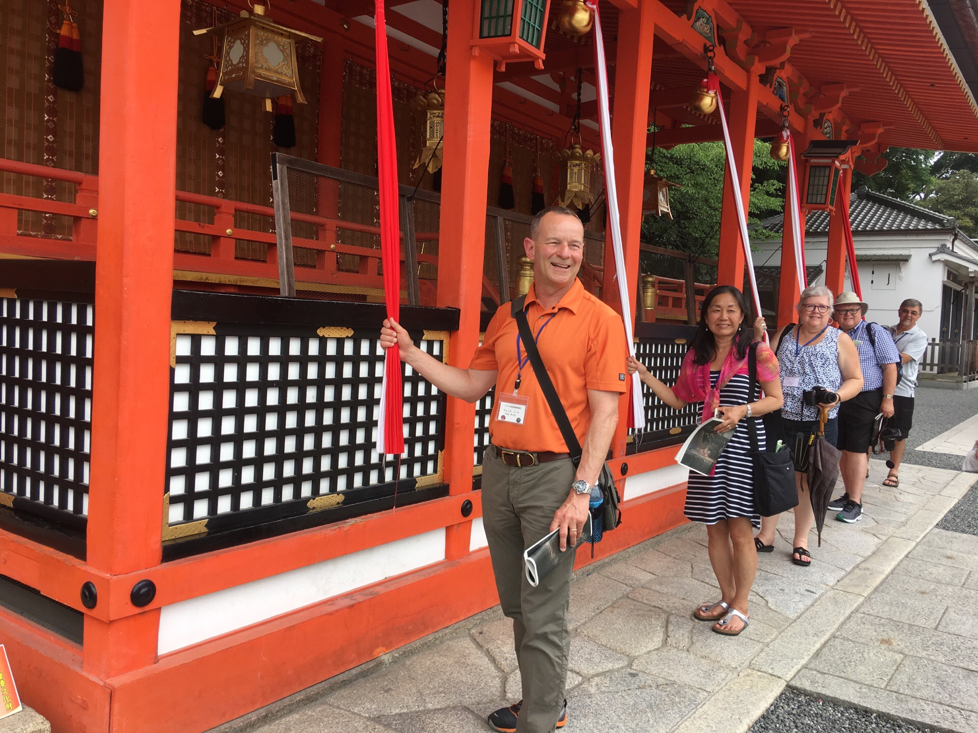 2016 Taber Delegates stand for a picture at one of the many sites of worship in Japan