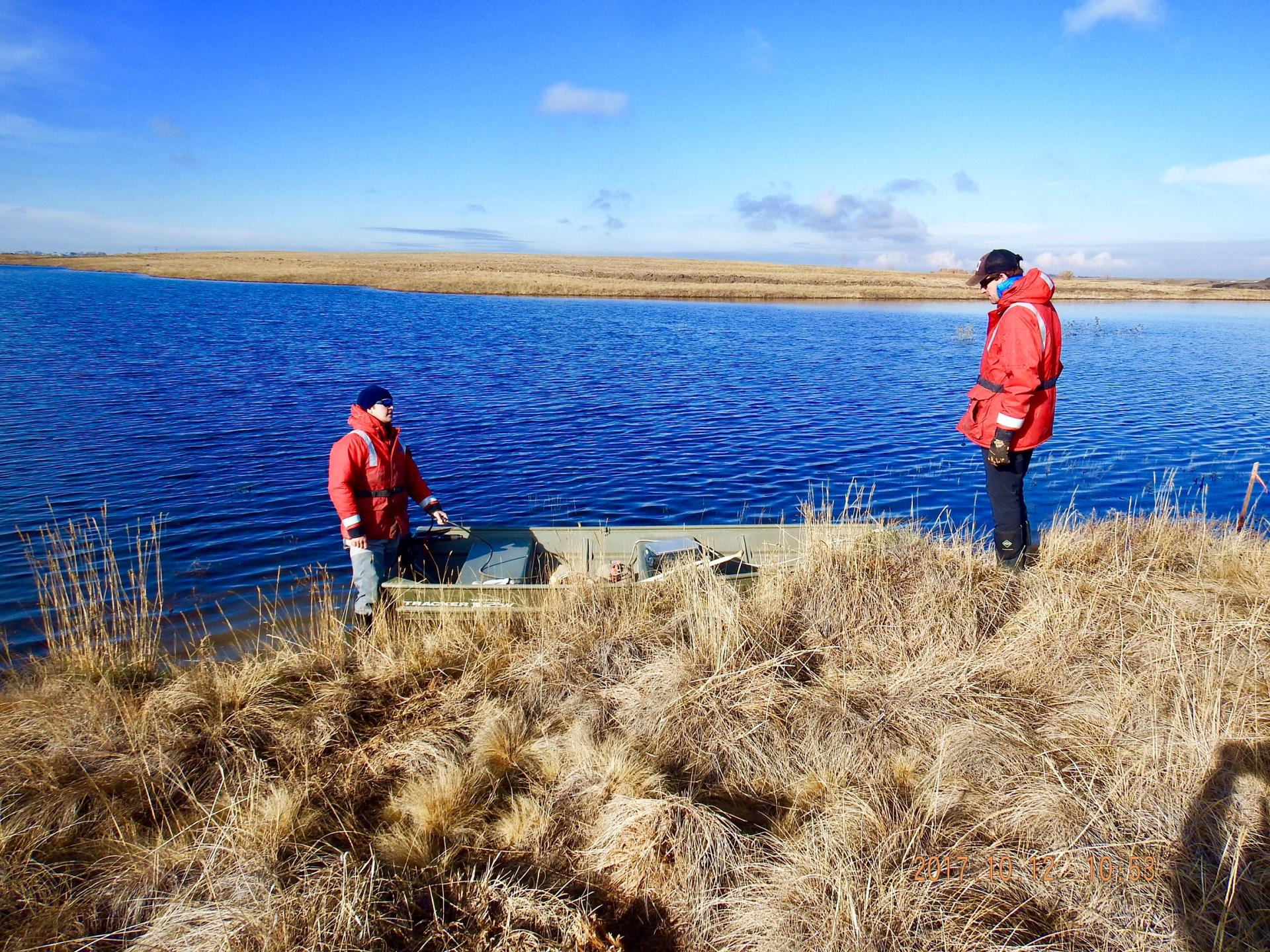 Alberta Conservation Checking Status of Trout Pond - October 2017