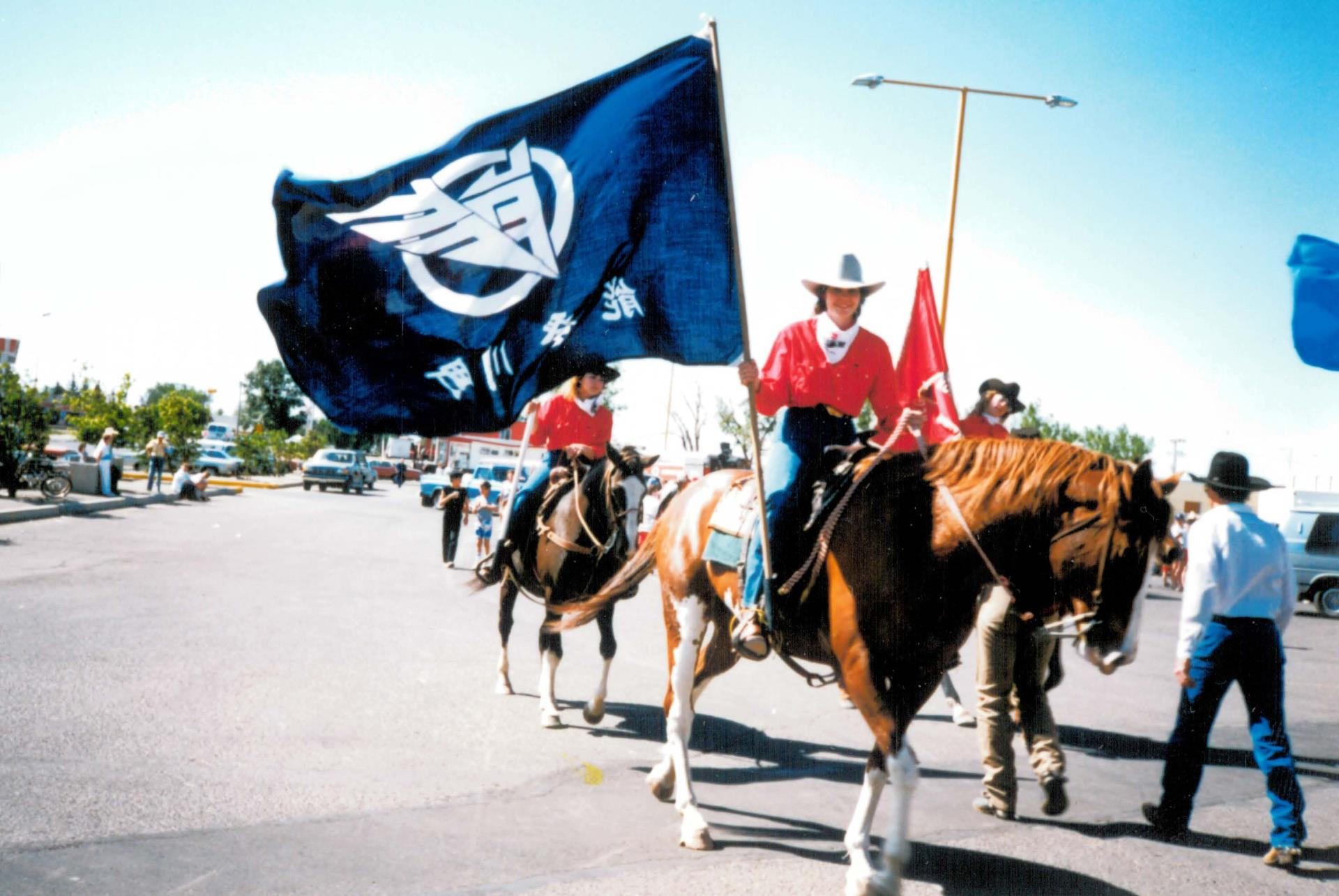 Notogawa Flag Flies in the Taber Parade