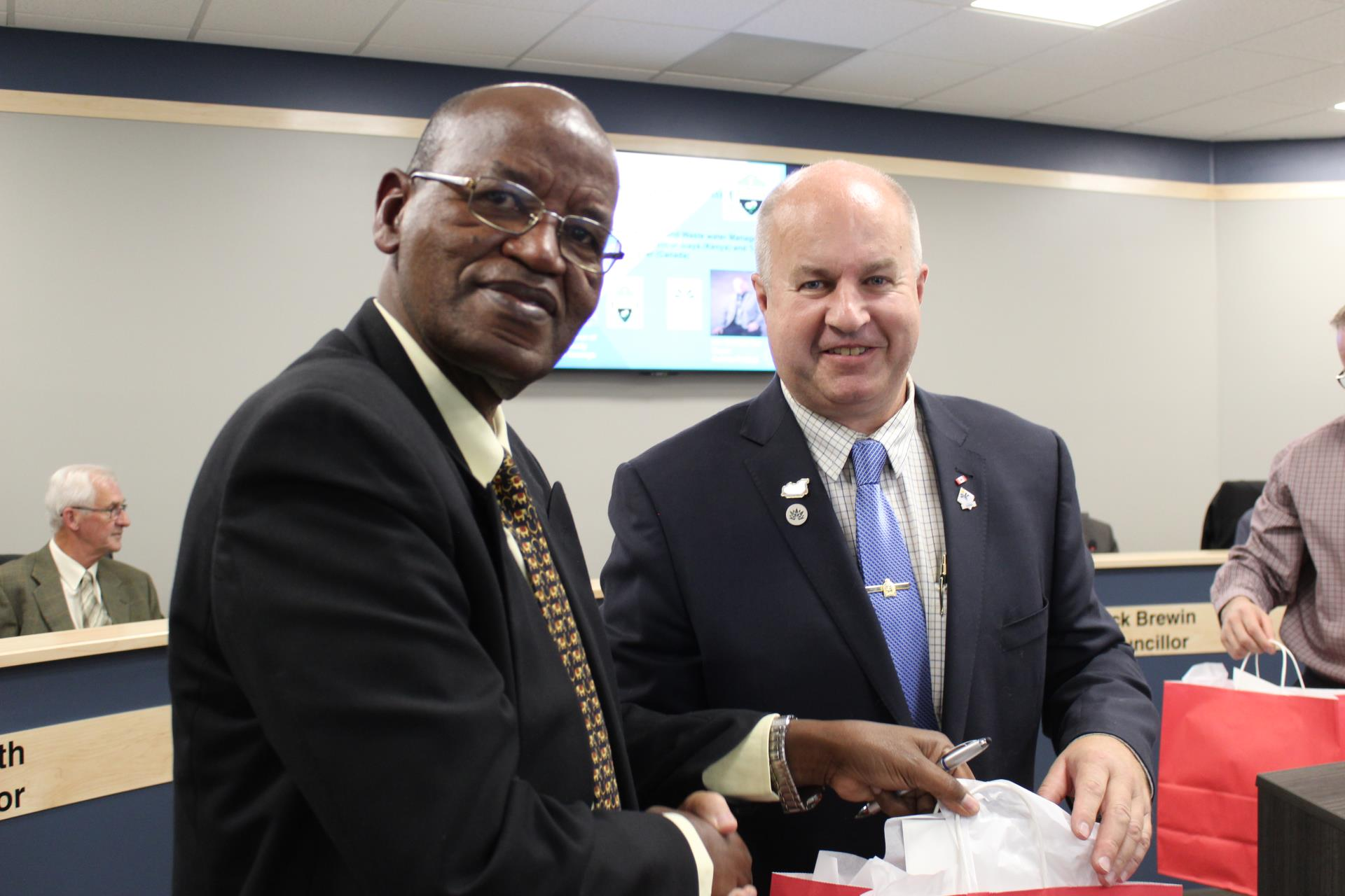 Mayor Prokop Presents a gift to Mr. Walter Ogwindo