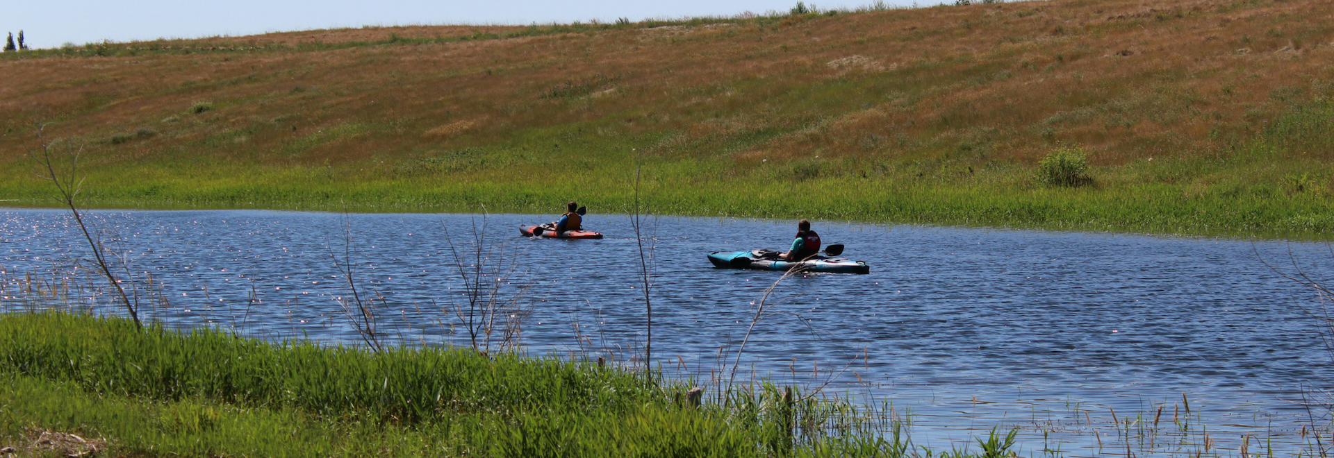 Kayaks on Trout Pond- Wide