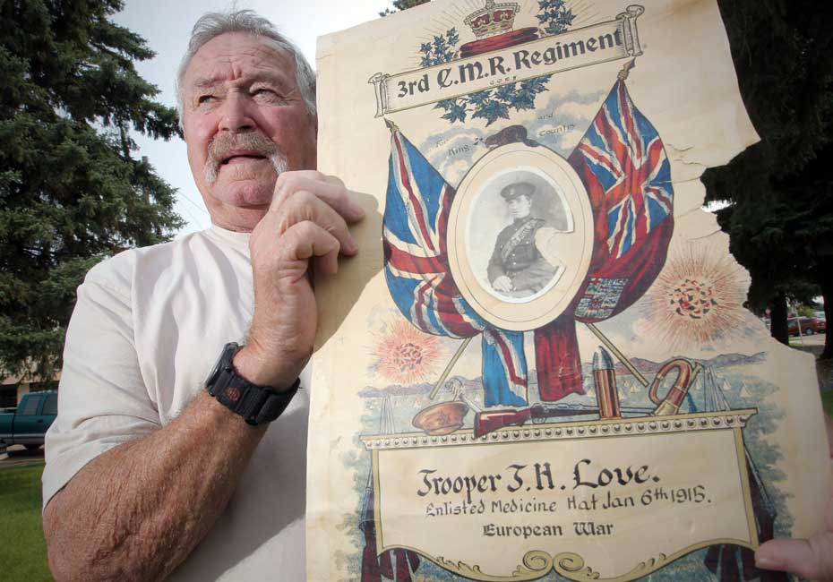 Doug Lacey holding a poster with photograph of his grandfather - picture by Stuart Gordon, Calgary Herald